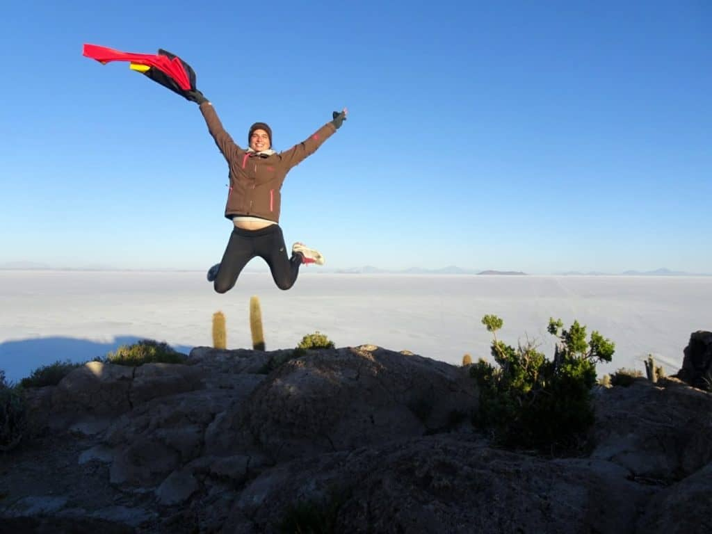 Jumping in the air before the Salar de Uyuni in Bolivia