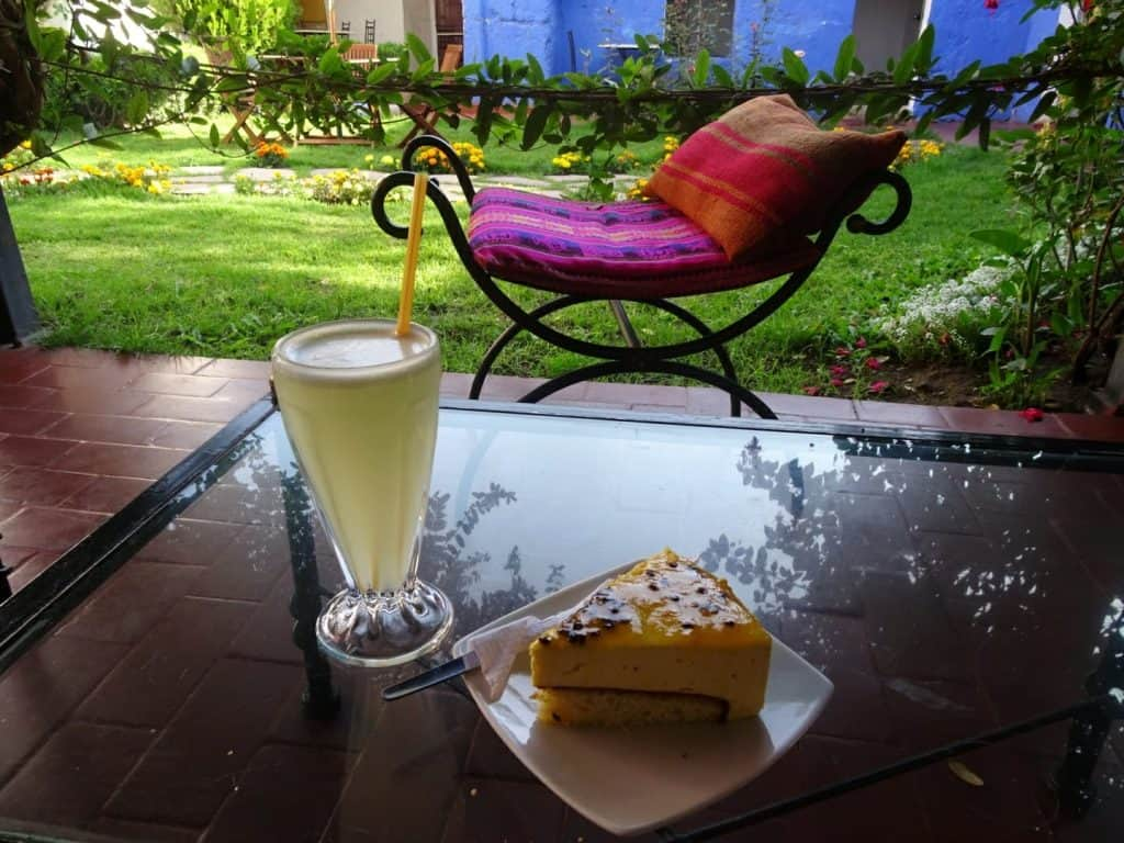 Cake and drink at Cafe garden in Santa Catalina Monastery, Arequipa, Peru
