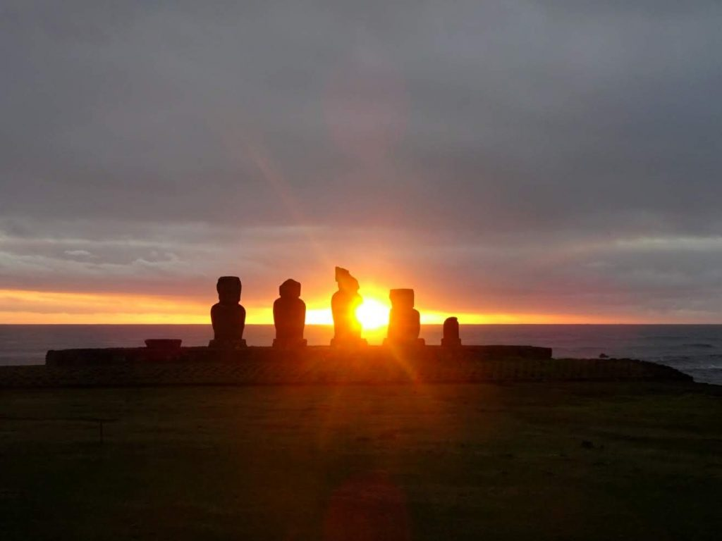 Sunset behind Maoi statues, Tahai, Easter Island, Chile, Pacific Ocean