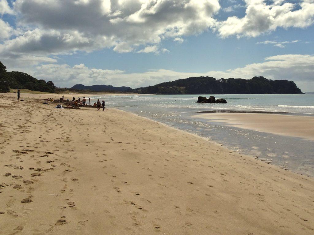 People enjoying hot springs at Hot Water Beach, Coromandel Peninsula, New Zealand