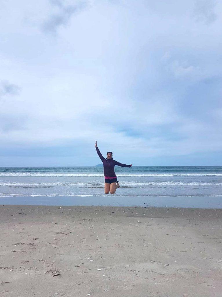 Jumping in the air at Waihi Beach, Coromandel Peninsula, New Zealand