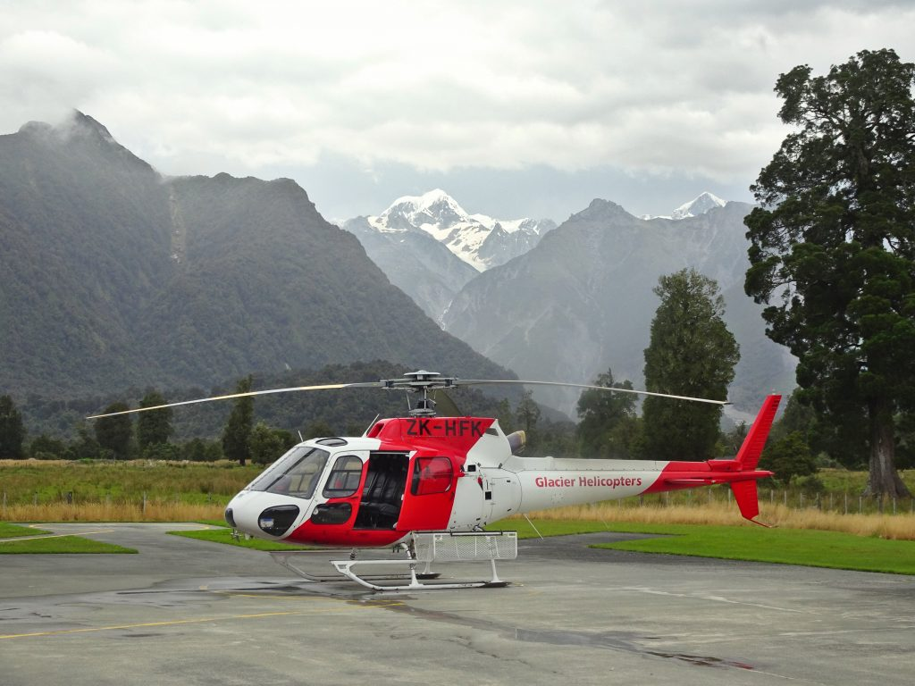 Helicopter in front of mountain range, New zealand