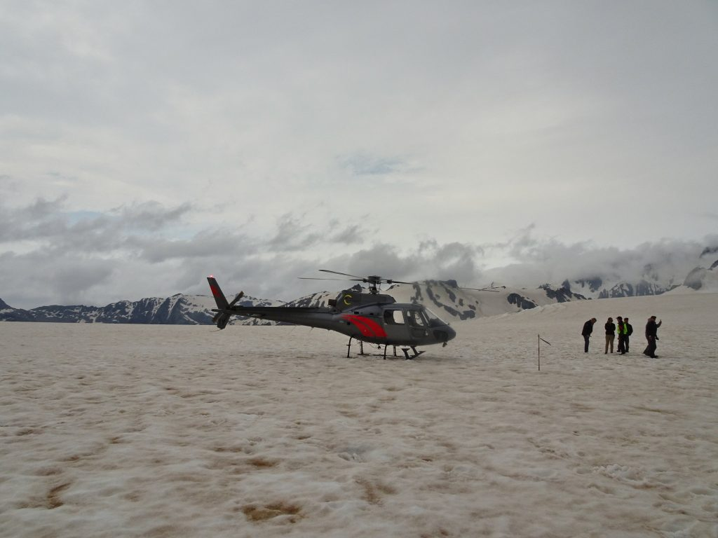 Helicopter landing on top of Fox Glacier, New Zealand
