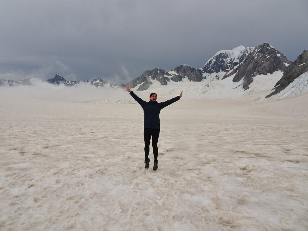 Jumping on top of Fox Glacier, New Zealand