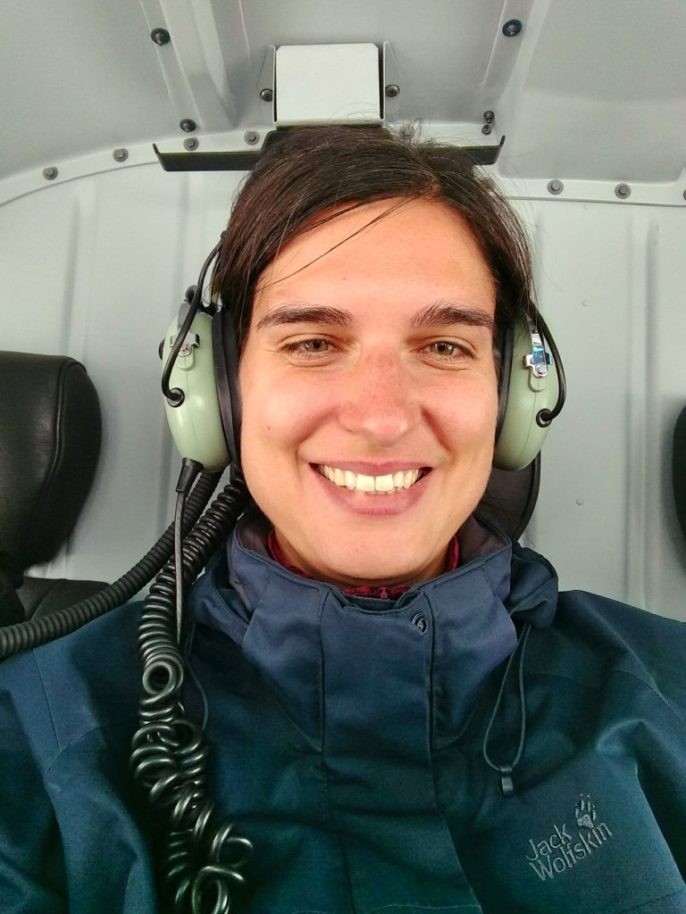 In helicopter with headset on