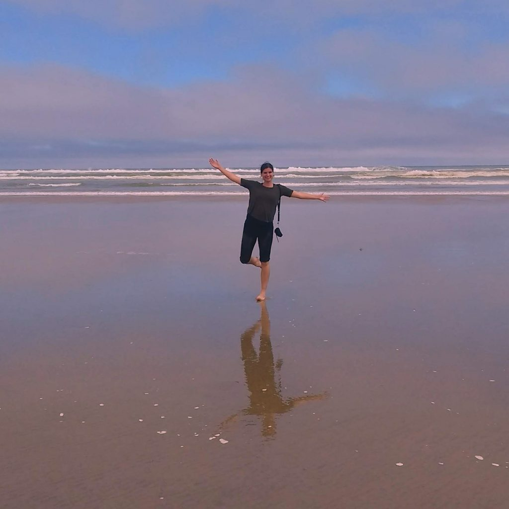 Posing for pictures at Ninety Mile Beach, New Zealand