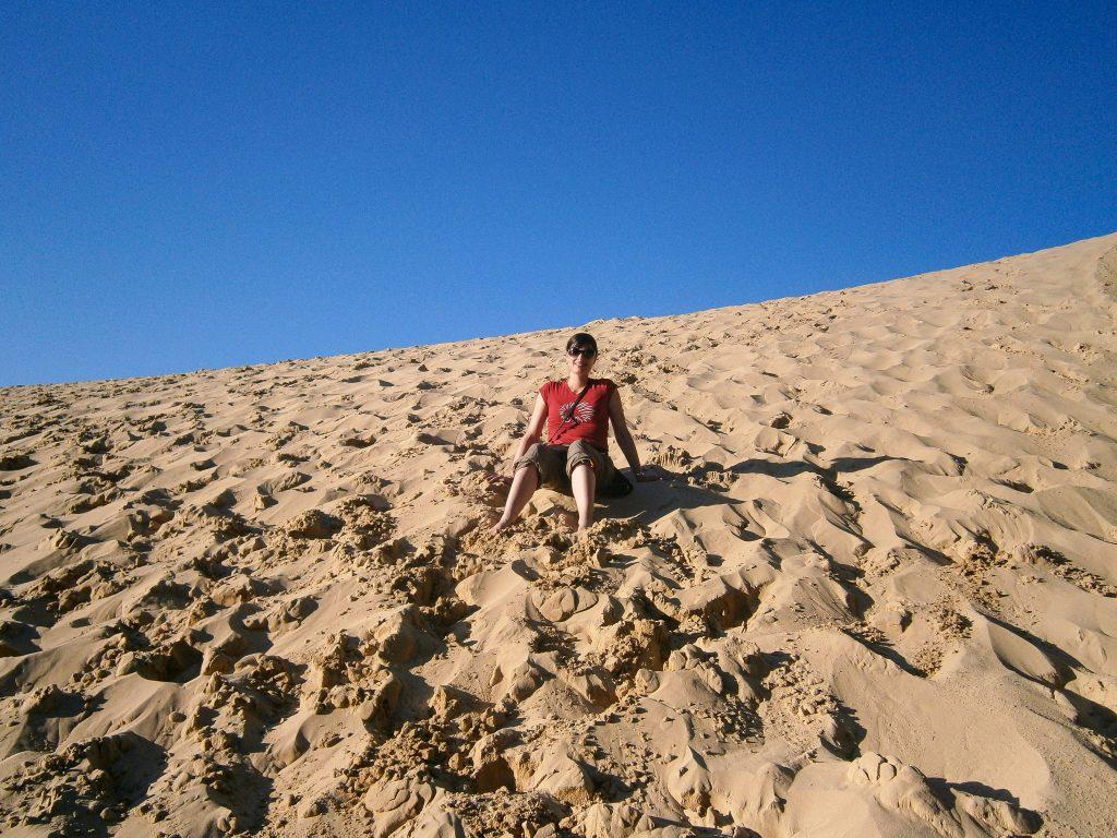 Sitting on a sand dune on Fraser Island Australia