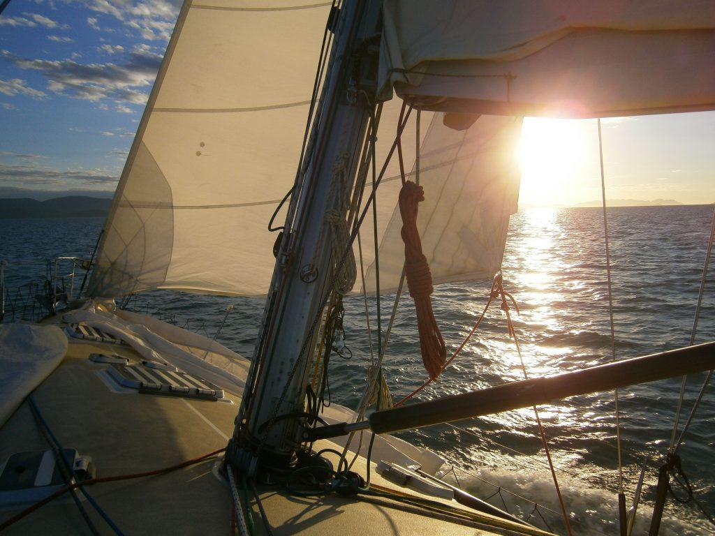 Sailing Boat in sunset, Whitsundays, Australia
