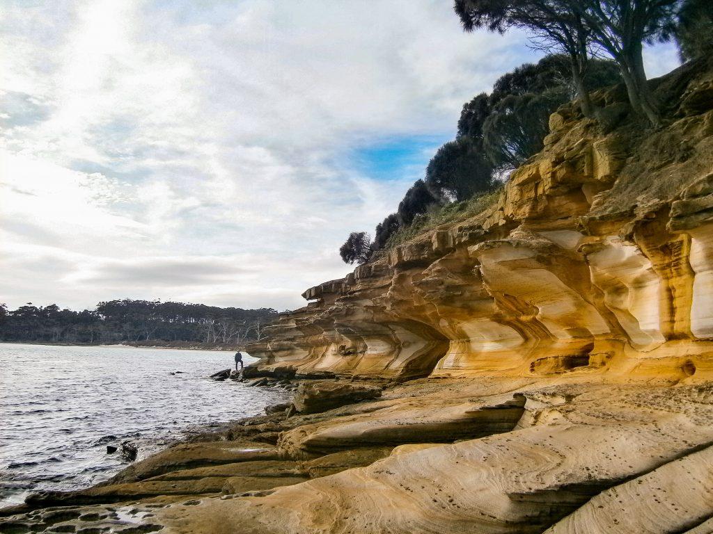 Coastal cliffs on Mariah Island, Tasmania, Australia - Planning an introvert-friendly trip