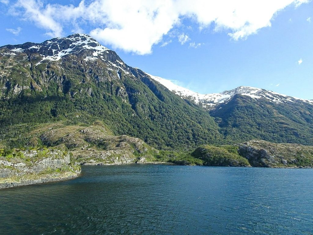 Snow-capped mountains before water, Patagonian fjords, Chile - Planning an introvert-friendly trip